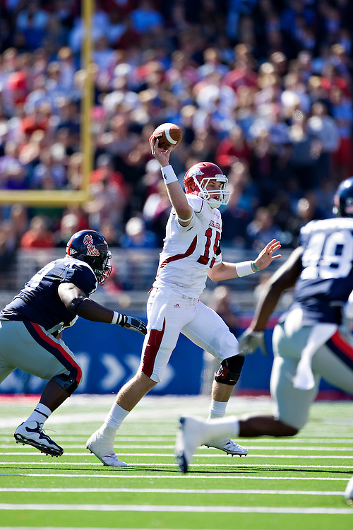 OXFORD, MS - OCTOBER 24:   Ryan Mallett #15 of the Arkansas Razorbacks throws a pass under pressure during a game against the Ole Miss Rebels at Vaught-Hemingway Stadium on October 24, 2009 in Oxford, Mississippi.  The Rebels defeated the Razorbacks 30 to 17.  (Photo by Wesley Hitt/Getty Images) *** Local Caption *** Ryan Mallett
