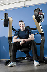 Smiling young man in gym
