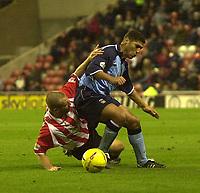 Photo. Glyn Thomas.<br /> Sunderland v Coventry City. Nationwide Division 1.<br /> Stadium of Light, Sunderland. 08/11/03.<br /> Sunderland's Darren Williams (L) brings attempts to bring down Youssef Safri.