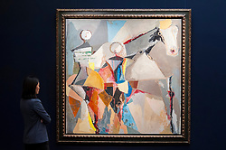 "© Licensed to London News Pictures. 30/09/2016. London, UK.  ""Grande Teatro"" by Marino Marini (est. GBP0.6-0.8 million) is viewed by a staff member at the preview of Sotheby's London upcoming Contemporary Art Auctions.  Photo credit : Stephen Chung/LNP"