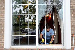 Workers repaired several windows at the Hilton Garden Inn in Charlotte, N.C., damaged after overnight protests following a fatal police shooting, on Thursday, Sept. 22, 2016. Photo by John D. Simmons/Charlotte Observer/TNS/ABACAPRESS.COM