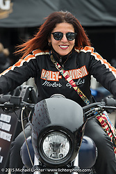"Viv Brumby of Melbourne, Australia is the publisher of the all Harley Heavy Duty Magazine with her husband Neale.  Here she is sitting on the Avengers Movie ""Street"" 750 that was ridden in the upcoming movie at the Harley-Davidson display at Daytona International Speedway on the first day of Daytona Beach Bike Week 2015. FL, USA. Saturday, March 7, 2015.  Photography ©2015 Michael Lichter."