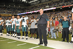DETROIT - SEPTEMBER 19: Head coach Andy Reid of the Philadelphia Eagles observes the National Anthem during the game against the Detroit Lions on September 19, 2010 at Ford Field in Detroit, Michigan. (Photo by Drew Hallowell/Getty Images)  *** Local Caption *** Andy Reid