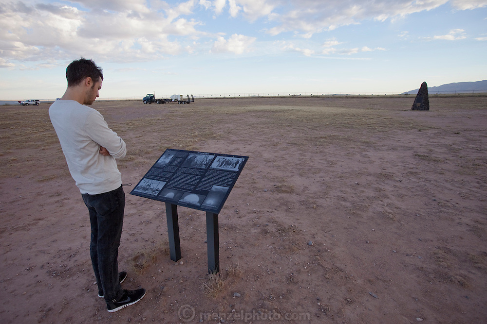 "Evan Menzel at Site Trinity, ground zero, on the White Sands Missile Range in S. New Mexico. Site of the world's first atomic explosion on July 16, 1945. The atomic bomb was developed by the Manhatten Project. The Manhattan Project refers to the effort during World War II by the United States, in collaboration with the United Kingdom, Canada, and other European physicists, to develop the first nuclear weapons. Formally designated as the Manhattan Engineering District (MED), it refers specifically to the period of the project from 1942-1946 under the control of the U.S. Army Corps of Engineers, under the administration of General Leslie R. Groves, with its scientific research directed by the American physicist J. Robert Oppenheimer. The project succeeded in developing and detonating three nuclear weapons in 1945: a test detonation on July 16 (the Trinity test) near Alamogordo, New Mexico; an enriched uranium bomb code-named ""Little Boy"" detonated on August 6 over Hiroshima, Japan; and a plutonium bomb code-named ""Fat Man"" on August 9 over Nagasaki, Japan. (http://en.wikipedia.org/wiki/Manhattan_Project) MODEL RELEASED."
