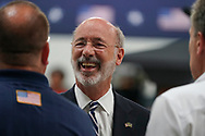 Pennsylvania Governor Tom Wolf talks to attendees before President Joe Biden delivers remarks July 28, 2021, following a tour of Mack Trucks Lehigh Valley Operations in Lower Macungie Township, Pennsylvania. The presidential visit was made to highlight the importance of American manufacturing, buying products made in America, and supporting good-paying jobs for American workers. (Photo by Matt Smith)