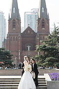 Visitors have wedding photos take in front of the St. Ignatius Church in Shanghai, China on 13 December, 2014.