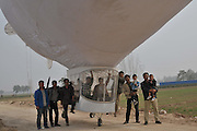 SHANGQIU, CHINA - OCTOBER 25: (CHINA OUT) <br /> <br /> Self-made Airship Tests Fly For Two Hours <br /> <br /> Shi Songbo, a 29-year-old man drives his self-made airship for a test in the sky on October 25, 2015 in Shangqiu, Henan Province of China. Shi Songbo, a man worked for design in a aircraft model enterprise made out an airship by himself in four months with own savings of more than 300,000 RMB (about 47,220 USD). The airship is in 23 meters long and 10 meters high and consist of two parts: a 10-meter-long airbag for hydrogen upside, and a cockpit that could accommodate two seaters downside. According to Shi Songbo, his idea of making airship was from those books about aerospace knowledge brought home by elder brother when he was in primary school. <br /> ©Exclusivepix Media