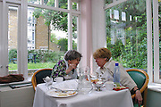 Elderly residents having discussions over lunch in Schonfeld square conservatory. Schonfeld square is an Orthodox Jewish (Kosher) old peoples care home run by Agudas Israel Housing Association in Stamford Hill, London.