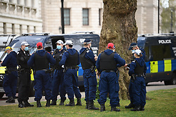 © Licensed to London News Pictures. 01/05/2021. London, UK. A heavy police presence in Westminster before Protesters gather in Trafalgar Square in central London to take part in a May Day Kill the Bill demonstration. Campaigners are opposing powers contained in the police, crime, sentencing and courts bill which would grant the police a range of new discretionary powers to shut down protests. Photo credit: Ben Cawthra/LNP