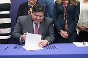 Illinois Governor J.B. Pritzker signs a bill into law at Northwestern Medicine Kishwaukee Hospital.  Photo by Mark Black