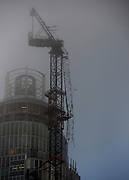 © Licensed to London News Pictures. 16/01/2013. London, UK A damaged crane is seen hanging from the side of the St George's Wharf development near Vauxhall in in London today (16/01/13) after a being hit by a helicopter, which then crashed.  Photo credit : Stephen Simpson/LNP
