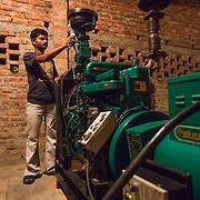 CAPTION: Controlling the gas value at DESI Power's Bara gasifier plant. LOCATION: Bara, Araria District, Bihar, India. INDIVIDUAL(S) PHOTOGRAPHED: Gurudev Malankar.