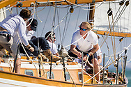 Tim Blackman, Admiral of the British Classic Yacht Club crewing on Barney Sanderman's Laughing Gull during the Panerai British Classic Sailing Week regatta.<br /> Picture date: Monday July 10, 2017.<br /> Photograph by Christopher Ison ©<br /> 07544044177<br /> chris@christopherison.com<br /> www.christopherison.com