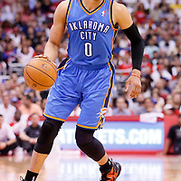 11 May 2014: Oklahoma City Thunder guard Russell Westbrook (0) dribbles during the Los Angeles Clippers 101-99 victory over the Oklahoma City Thunder, during Game Four of the Western Conference Semifinals of the NBA Playoffs, at the Staples Center, Los Angeles, California, USA.