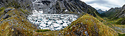 Ice-filled Crucible Lake in summer in Mount Aspiring National Park, Southern Alps, Otago region, South Island of New Zealand. Beginning in the Siberia Valley, the Crucible Lake Track departs from the Gillespie Pass Circuit about an hour above the Siberia Hut. UNESCO lists Mount Aspiring as part of Wahipounamu - South West New Zealand World Heritage Area. This image was stitched from multiple overlapping photos.
