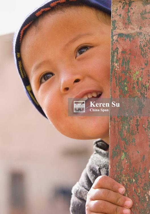 Boy by the door, Kashgar, Xinjiang, China