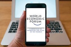Using iPhone smart phone to display website logo of World Economic Forum