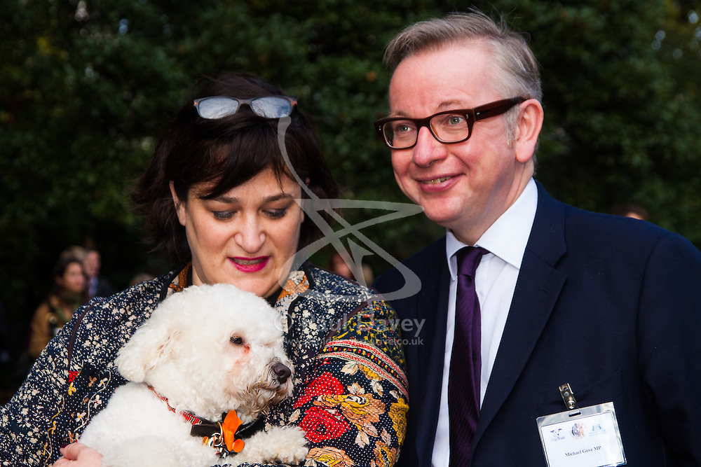 London, October 23rd 2014. Organised by the Dogs Trust and the Kennel Club, politicians  and their pooches gather outside Parliament for the 22nd Westminster Dog of the Year competition, aimed at raising awareness of dog welfare in the UK where the Dogs Trust cares for over 16,000 stray and abandoned dogs annually. PICTURED: Michael Gove and his wife Sarah Vine pose for pictures with their dog Snowy, a Bichon Fris cross.