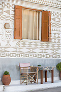 Close up of chair and table outside decorated house, Pyrgi, Chios, Greece
