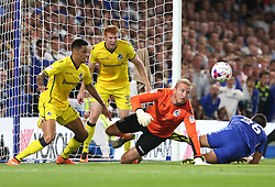 23 August 2016 - EFL Cup - Chelsea v Bristol Rovers<br /> Bristol Rovers goalkeeper Steve Mildenhall keeps his eye on the ball after making a save ; Daniel Leadbitter and Rory Gaffney of Bristol Rovers defend behind<br /> Photo: Charlotte Wilson
