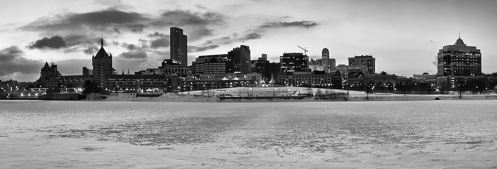 Albany, NY.  This is a little out of my realm, as I avoid cities to a large extent.  But a friend was looking for a print of the Albany skyline that she is so familiar with, living across the river is Renssalaer.  So on an evening promising to be colorful with a sunset, I went to a spot I knew down on the shoreline.  It was a bit of a precarious perch on the blocks of an old foundation, and it was bitterly cold with the breeze coming across the flat, frozen surface of the Hudson.  I took a series of shots during a briefer color event than I thought it would be, and the city lighting up with man made light as well.  I retreated with frozen fingers.  The woman decided she wanted a black and white version as well, and this is the result of that endeavor.  Both are presented in this gallery.