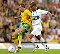 Photo: Daniel Hambury.<br /> Norwich City v Inter Milan. Pre Season Friendly.<br /> 29/07/2005.<br /> Norwich's Darren Huckerby takes the ball away from Inter's Jose Ze Maria.