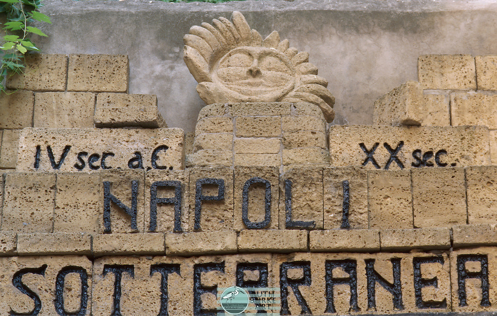 Sign at entrance to ancient baths in Naples, Italy. Fountains,Tiles,Plants and Pots