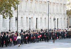 Members of the public make their way down Whitehall in The People's Procession after the remembrance service at the Cenotaph memorial in Whitehall, central London, on the 100th anniversary of the signing of the Armistice which marked the end of the First World War.