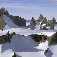 ANTARCTICA, Queen Maud Land. Fenris Mountains above Fenris Tongue Glacier (Fenristunga). 2931m Ulvetanna on left.