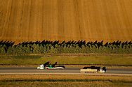 Trucks carrying equipment and oil, drive on U.S. Hwy 85 in McKenzie County south of Williston, N.D., Sept 24, 2013. In 2008 the North Dakota oil boom started its ongoing period of extraction of oil from the Bakken formation. The amount of jobs the oil boom has provided North Dakota has helped give it the lowest unemployment rate in the United States and and gave it a billion dollar surplus. Shale gas reserves has given the United States more independence over other nations such as Venezuela and countries in the Middle East.  Photo Ken Cedeno