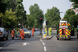 © Licensed to London News Pictures. 24/06/2021. London, UK. Emergency services at the scene in St John's Wood, North London, where a burst pipe has has cause flooding across a number of streets in the area. Photo credit: Ben Cawthra/LNP