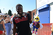 Bakary Sako of Crystal Palace holds up a stuffed Eagles soft toy outside Selhurst Park before k/o. Barclays Premier league match, Crystal Palace v Aston Villa at Selhurst Park in London on Saturday 22nd August 2015.<br /> pic by John Patrick Fletcher, Andrew Orchard sports photography.