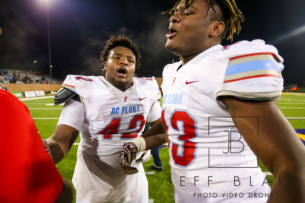 AC Flora Falcons defensive lineman Jaylin Brown (42) and AC Flora Falcons defensive lineman Omarion Hammond (43) celebrate following their State Championship win over the North Myrtle Beach Chiefs at Benedict College.