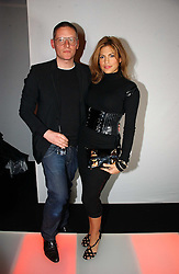 Actress EVA MENDES and designer GILES DEACON at a party to celebrate the launch of a range of leather accessories designed by Giles Deacon for Mulberry held at Harvey Nichols, Knightsbridge, London on 30th October 2007.<br /><br />NON EXCLUSIVE - WORLD RIGHTS