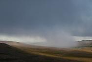 A rain shower moves across the land in the Katmai National Preserve, Alaska