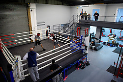 © London News Pictures. 29/12/2016. Two-weight world boxing champion, Carl Frampton (black t-shirt), nickname The Jackal, sparring at his gym in south London. Frampton has been named ESPN's fighter of the year. Photo credit: Ben Cawthra/LNP