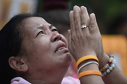 October 13, 2016 - Bangkok, Thailand - Thais cries while praying for Thai King Bhumibol Adulyadej at the Siriraj Hospital in Bangkok, Thailand on October 13, 2016. (Credit Image: © Wasawat Lukharang/NurPhoto via ZUMA Press)