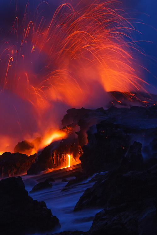 Vigorous activity at the Waikupanaha ocean entry is marked by spectacular littoral explosions and subtle drips.