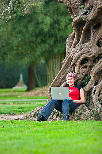 Sarah Meredith working on Apple Powerbook computer in Capitol Park. Sacramento, CA<br />