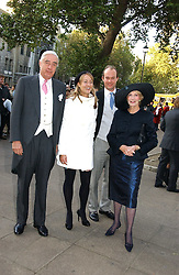 MR & MRS RUPERT HAMBRO, their daughter FLORA HAMBRO and HENRY NEAME at the wedding of Clementine Hambro to Orlando Fraser at St.Margarets Westminster Abbey, London on 3rd November 2006.<br /><br />NON EXCLUSIVE - WORLD RIGHTS