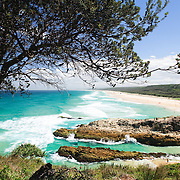 Looking south along the surf beaches of Stradbroke Island from the top of Point Lookout, Queensland's most easterly point. The rocky headland is one of the few breaks in Stradbroke's long, sandy beaches facing the Pacific Ocean. North Stradbroke Island, just off Queensland's capital city of Brisbane, is the world's second largest sand island and, with its miles of sandy beaches, a popular summer holiday destination.