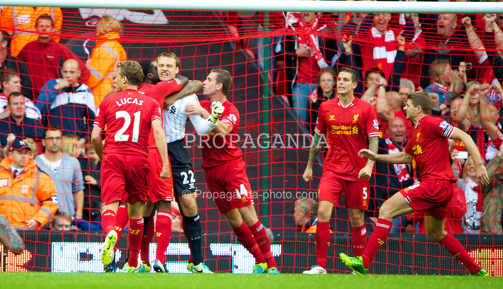 LIVERPOOL, ENGLAND - Saturday, August 17, 2013: Liverpool's goalkeeper Simon Mignolet celebrates with team-mates after saving a late Stoke City penalty during the Premiership match at Anfield. (Pic by David Rawcliffe/Propaganda)