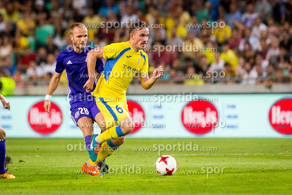 Tilen Klemencic of NK Domzale and Valere Germain of Olympic Marseille  during football match between NK Domzale and Olympique de Marseille in First game of UEFA Europa League playoff round, on August 17, 2017 in SRC Stozice, Ljubljana, Slovenia. Photo by Ziga Zupan / Sportida