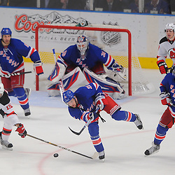 May 16, 2012: New York Rangers center Derek Stepan (21) dumps the puck away from New Jersey Devils center Travis Zajac (19) on the penalty kill during third period action in game 2 of the NHL Eastern Conference Finals between the New Jersey Devils and New York Rangers at Madison Square Garden in New York, N.Y. The Devils defeated the Rangers 3-2.
