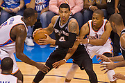 June 2, 2012; Oklahoma City, OK, USA; Oklahoma City Thunder guard Russell Westbrook (0) applies pressure as San Antonio Spurs guard Danny Green (4) looks to make a pass during a playoff game  at Chesapeake Energy Arena.  Thunder defeated the Spurs 109-103 Mandatory Credit: Beth Hall-US PRESSWIRE