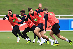 England's Harry Maguire (centre), James Tarkowski (right), Ben Chilwell, and Demarai Gray during the training session at St Georges' Park, Burton. PRESS ASSOCIATION Photo. Picture date: Monday September 10, 2018. See PA story SOCCER England. Photo credit should read: Mike Egerton/PA Wire. RESTRICTIONS: Use subject to FA restrictions. Editorial use only. Commercial use only with prior written consent of the FA. No editing except cropping.