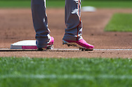 A close up view of one of the bases and the pink cleats worn by Nick Markakis #21 of the Baltimore Orioles during a game against the Minnesota Twins on Mother's Day on May 12, 2013 at Target Field in Minneapolis, Minnesota.  The Orioles defeated the Twins 6 to 0.  Photo: Ben Krause