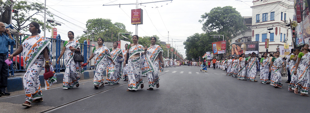 May 2, 2019 - Kolkata, West Bengal, India - Trinamool Congress or TMC women activist wears sarees printed with their party symbol during an election campaign road show in support of their South Kolkata Lok Sabha constituency candidate Mala Roy ahead of Lok Sabha polls. (Credit Image: © Saikat Paul/Pacific Press via ZUMA Wire)