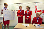 CRAWLEY, WEST SUSSEX, UK, OCTOBER 27TH 2011. Virgin Atlantic air stewardess give a presentation in a training class at The Base training facility. These trainees have one week to go before they pass the 6 week course and collect their 'wings'. (Photo by Mike Kemp for The Washington Post)