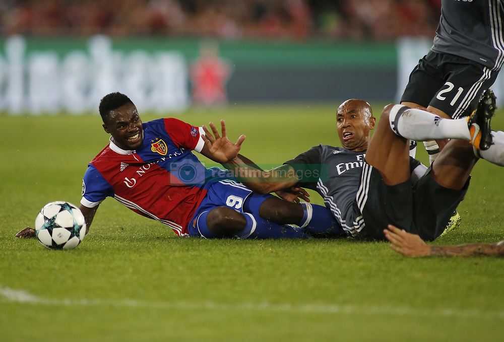 BASEL, Sept. 28, 2017  Dimitri Oberlin (L) of Basel competes with Luisao of Benfica during the UEFA Champions League group A match between Basel and Benfica in Basel, Switzerland, on Sept. 27, 2017. Basel won 5-0. (Credit Image: © Michele Limina/Xinhua via ZUMA Wire)